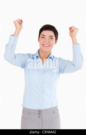 Portrait of a cheerful businesswoman with the fists up - Stock Photo
