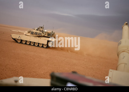 Two M1A1 Abrams Main Battle Tanks patrol with Task Force Mech, Regimental Combat Team 5 in al-Anbar Province, Iraq, - Stock Photo