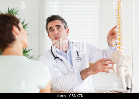 Male Doctor explaining something to a woman - Stock Photo