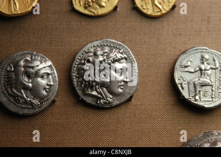 Ancient Greek coins of Alexander the Great from the numismatic collection of the Pergamon Museum in Berlin, Germany. - Stock Photo