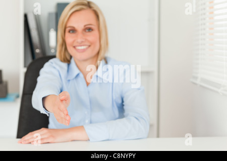 Businesswoman giving hand - Stock Photo