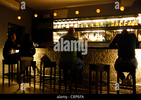 People sitting in Beit Aneeseh bar in downtown Ramallah West bank Palestinian Territories - Stock Photo