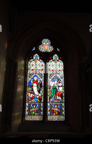A stained glass window in St Michaels and All Angels Church, Urchfont, Wiltshire - Stock Photo