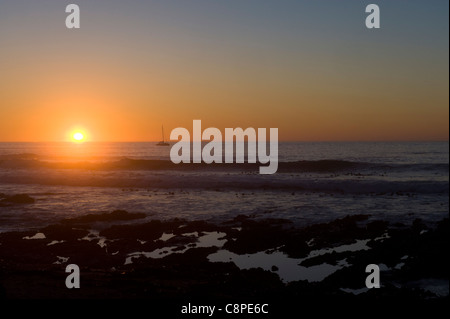 Sunset over the Atlantic Ocean view from Moille Point Cape Town South Africa - Stock Photo