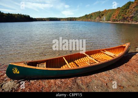 Canoe on the shore of  Walden Pond, Concord, Massachusetts - Stock Photo