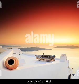 A sunset over Santorini island - Stock Photo