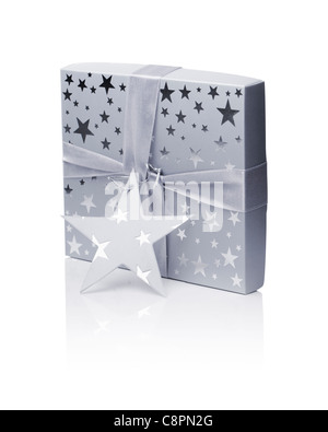 A Gift box (containing a CD) isolated on white with natural reflection. - Stock Photo