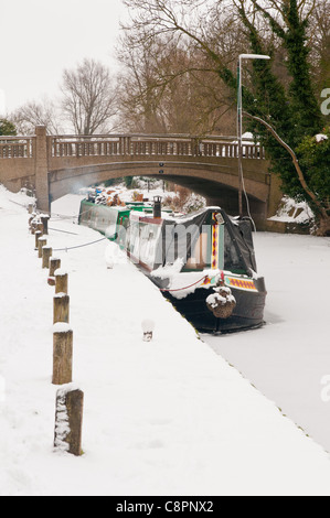 Canal boats on the frozen River Stort and the Stort Navigation at Harlow Mill Lock, Essex. - Stock Photo