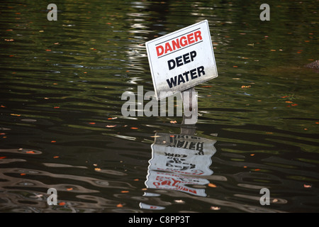 'danger deep water' sign in a pond - Stock Photo