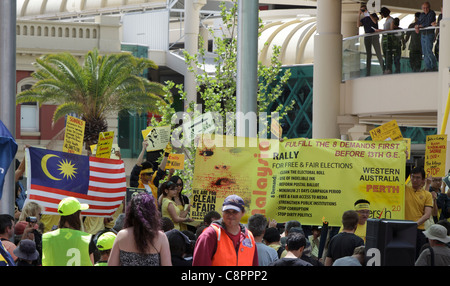 Malaysian protesters with banner demanding electoral reform at Occupy Perth /  CHOGM 2011 protests. - Stock Photo