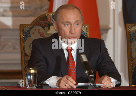 Russian president Vladimir Putin attends a news conference during his visit to Prague, Czech Republic on 1 March - Stock Photo