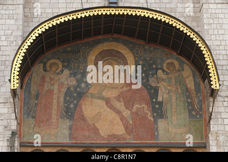 Fresco of the Virgin of Vladimir over the main gate of the Dormition Cathedral in Moscow Kremlin, Russia. - Stock Photo