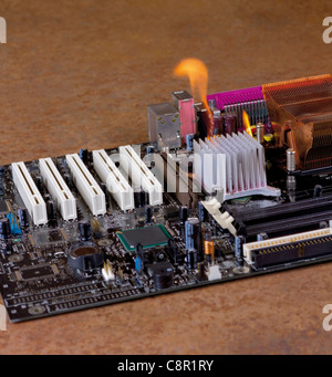 detail of a burning main board located in rusty ambiance - Stock Photo