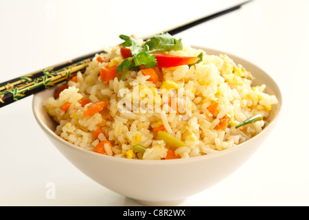 Fried rice with vegetable ,egg and pork - Stock Photo