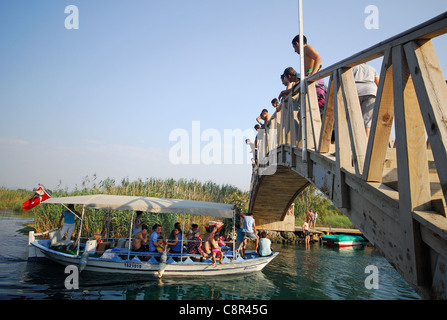 AKYAKA, TURKEY. A pleasure boat taking holidaymakers along the Azmak river. 2011. - Stock Photo