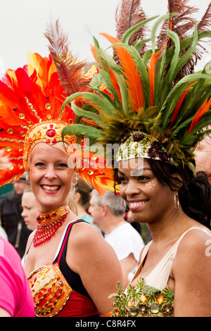 PORTSMOUTH, UK, 30/10/2011. Two members of the public prepare to begin the Bupa Great South Run in colourful costumes. - Stock Photo