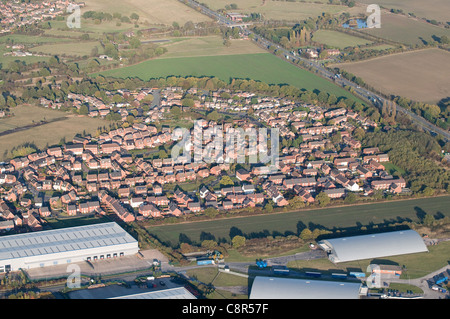 Aerial view of Fradley village near Lichfield Staffordshire England with industrial units in foreground and A38 - Stock Photo