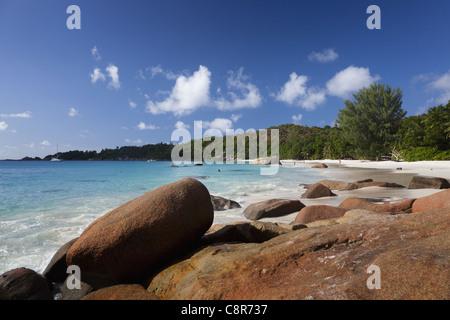 Granite boulders on the shore at Anse Lazio, Baie Sainte Anne district, Island of Praslin, Seychelles, Indian Ocean, - Stock Photo