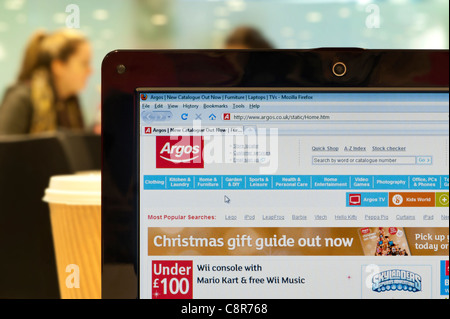 The Argos website shot in a coffee shop environment (Editorial use only: ­print, TV, e-book and editorial website). - Stock Photo