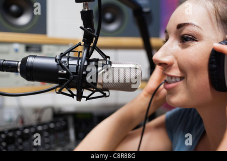 Close up of a young radio host speaking - Stock Photo
