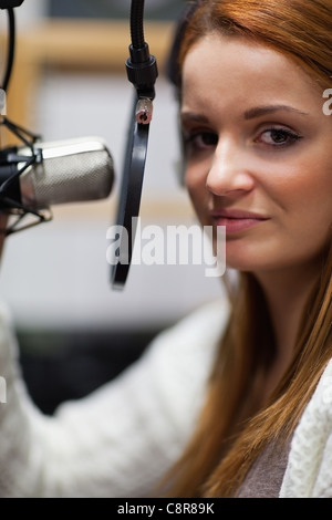 Portrait of a young radio host posing - Stock Photo