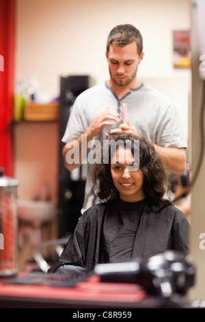 Portrait of a man combing hair - Stock Photo