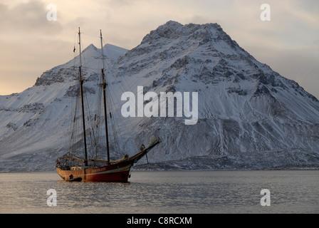 The schooner S/V Noorderlicht with its Zodiac, Trygghamna, Isfjord, Spitsbergen - Stock Photo