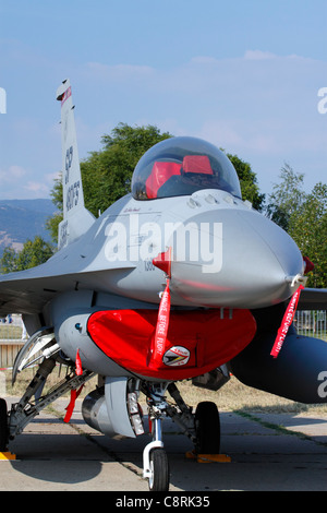US Air Force F-16C Fighting Falcon fighter jet on its parking position with covered air inlet - Stock Photo