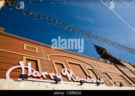 Harry Ramsden's fish and chip restaurant and the Blackpool Tower in Blackpool, UK - Stock Photo