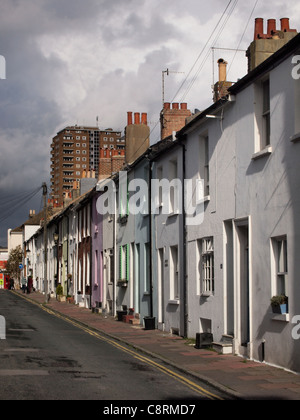 A row of side-lit terraced houses and homes in a street in Brighton, England. - Stock Photo