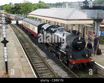 Steam train on East Lancashire Railway at Ramsbottom Station - Stock Photo