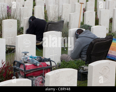 Graves being cleaned at the Tynecot Cemetery for World War One soldiers killed in the Ypres vicinity, Belgium, EU - Stock Photo