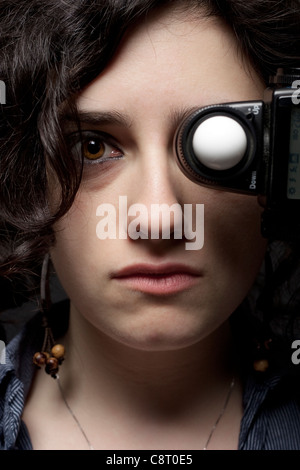 Woman with Light Meter on Her Eye - Stock Photo