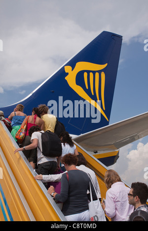Passengers board a Ryanair flight through the rear door of the plane - Stock Photo