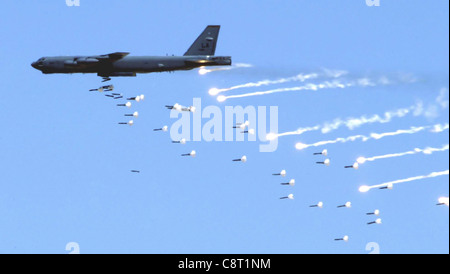 NELLIS AIR FORCE BASE, Nev. -- A B-52 Stratofortress from Barksdale Air Force Base, La., drops live ordnance over - Stock Photo