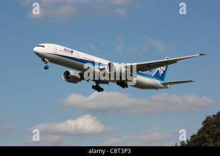 ANA Boeing 777-300ER long haul widebody passenger jet plane on approach to London Heathrow - Stock Photo