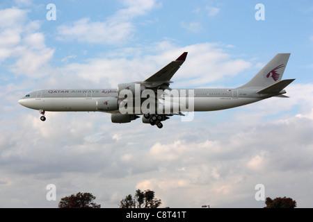 Qatar Emiri Flight Airbus A340-500 VIP transport jet on approach to London Heathrow - Stock Photo