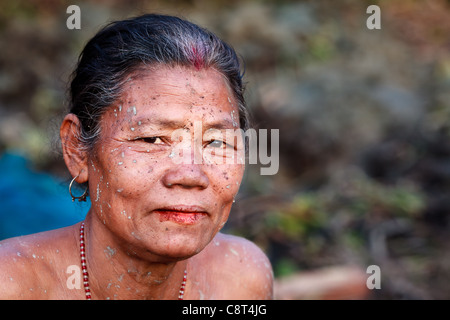 Afternoon portrait of elderly woman from the Mishing tribe from Majuli Island in the Brahmaputra river, Assam, India - Stock Photo