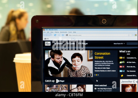 The ITV website shot in a coffee shop environment (Editorial use only: print, TV, e-book and editorial website). - Stock Photo
