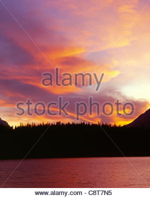 Flaming sunset over Mt. Bosworth and Herbert Lake, Rocky Mountains, Banff National Park, Alberta, Canada - Stock Photo