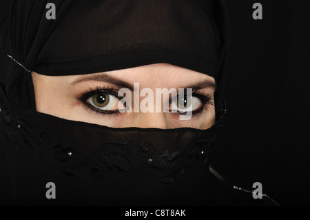 Close up picture of a Muslim woman wearing a veil - Stock Photo