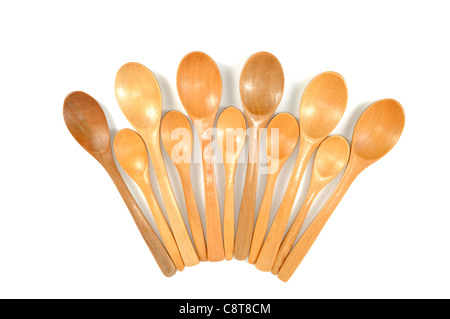 Assortment of handmade wooden spoons, on a white background - Stock Photo