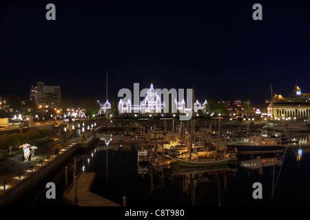 Parliament Buildings from the Inner Harbour in Victoria BC Canada at Night - Stock Photo