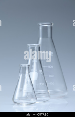 Three Glass Beakers With White Background - Stock Photo