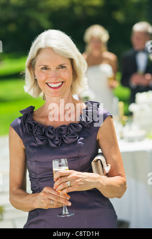 USA, New York State, Old Westbury, Portrait of mother of bride at wedding reception - Stock Photo