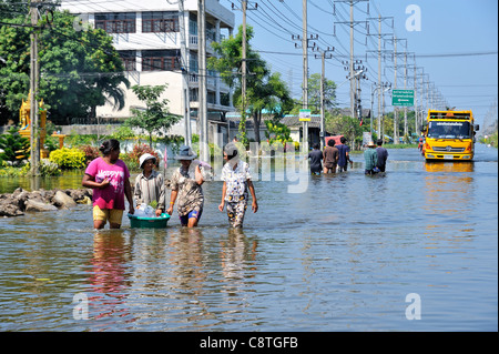 People walking on a flooded street during the severe floods in Thailand in 2011. - Stock Photo