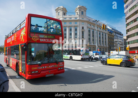 Red double-deck tour bus with open top on Passeig de Gracia. Barcelona, Catalonia, Spain. - Stock Photo