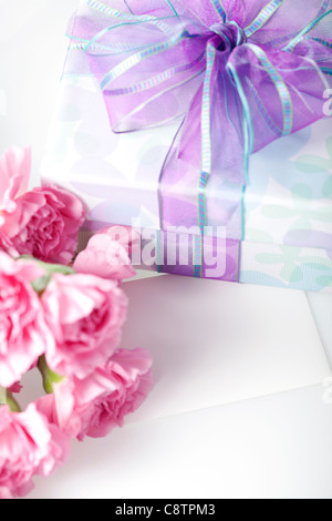 Wrapped Gift Box, Pink Carnation Flowers And Card - Stock Photo