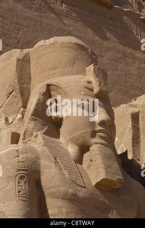 Egyptian art. Great Temple of Ramses II. Colossal statues depicting the pharaoh Ramses II (1290-1224 BC). Abu Simbel. - Stock Photo