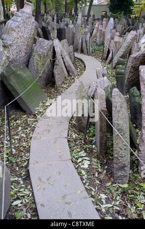 Old Jewish cemetery in Josefov in Prague in Czech Republic - Stock Photo